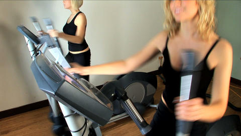 Beautiful blonde girls enjoy working out at the gym Footage