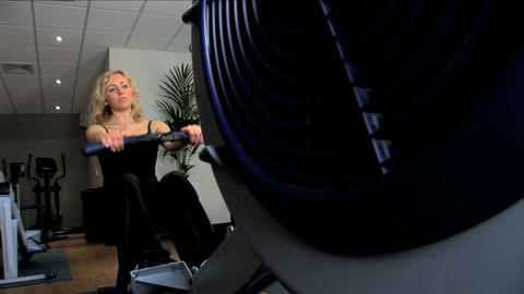 Beautiful blonde girl enjoys exercising at the gym Stock Video Footage