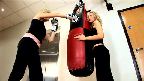 Beautiful blonde girls boxing at the gym Footage