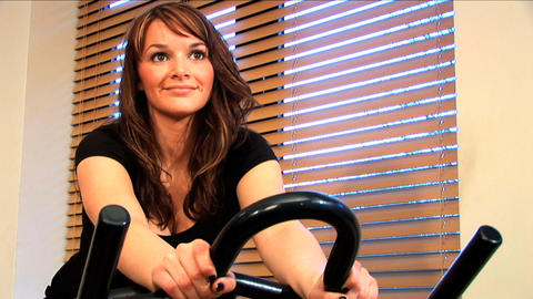 Beautiful brunette enjoys working out at the gym Stock Video Footage