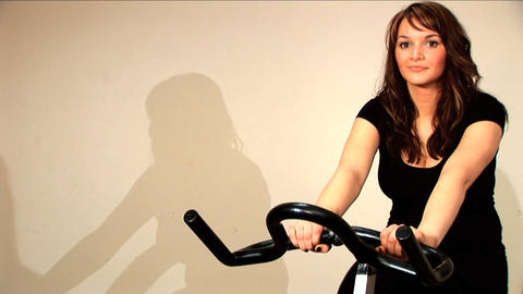 Beautiful brunette girl enjoys working out at the gym Stock Video Footage
