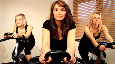 Beautiful girls enjoy working out at the gym Stock Video Footage