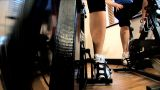 Close-up Legs & Feet Working An Exercise Machine At A Gym stock footage