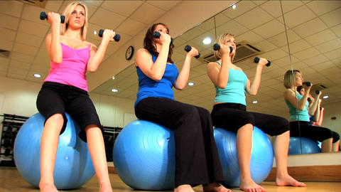 Beautiful young girls doing exercises at a gym Stock Video Footage