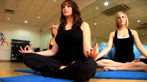 Beautiful Young Girls Doing Yoga Exercises At A Gym stock footage
