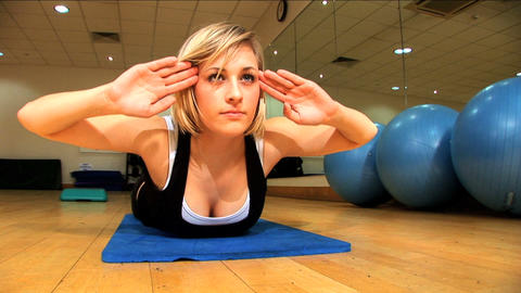 Beautiful blonde girl exercising at the gym Stock Video Footage