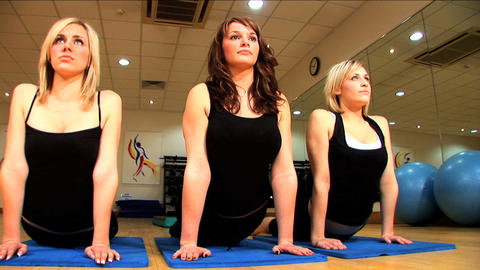 Beautiful young girls exercising at a gym Footage