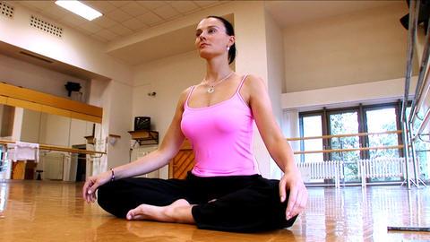 Attractive slim brunette girl practising yoga exercises... Stock Video Footage