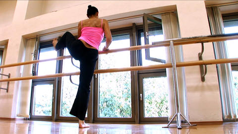 Attractive slim brunette girl practising yoga exercises... Stock Video Footage