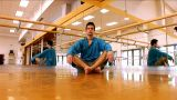 Attractive Young Man Practising Yoga Exercises At A Gym stock footage
