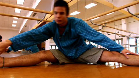 Attractive young man practising yoga exercises at a gym Stock Video Footage