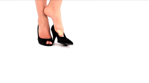 Woman taking off her shoes and having a rest Stock Video Footage