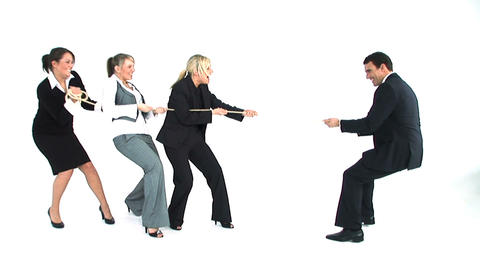 Tug of war between male and female business people Stock Video Footage