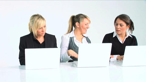 Three women working with computer Footage