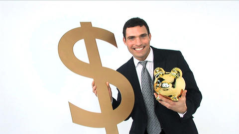 Businessman holding gold piggy bank and dollar symbol isolated on white Footage