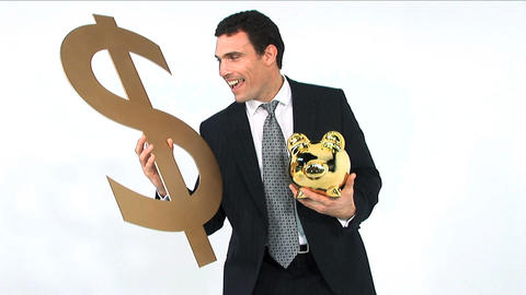 Businessman holding gold piggy bank and dollar symbol... Stock Video Footage