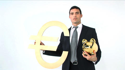 Businessman holding gold piggy bank and euro symbol isolated on white Footage