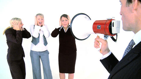 Businessman speaking throught a megaphone at his assistants, motion jib Footage