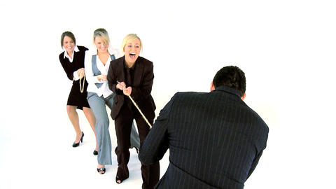 Tug of war between male and female business people Footage