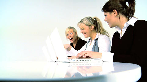 Three businesswomen working with computer Footage