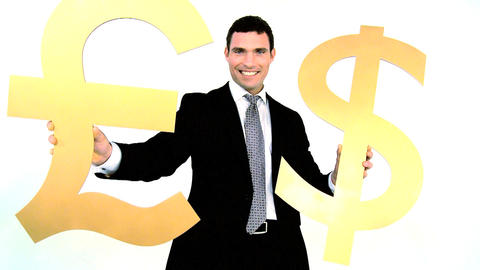 Businessman holding gold dollar and pound symbol isolated on white Footage