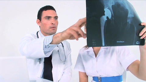 Healthworkers analyzing x-ray Stock Video Footage
