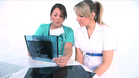 Young women medical team analyzing x-ray Footage