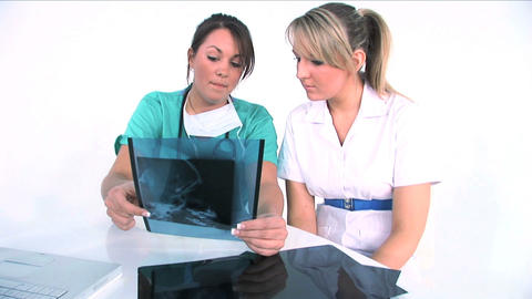Young women medical team analyzing x-ray Stock Video Footage