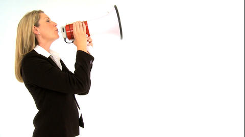 Beautiful businesswoman shouting through a megaphone Footage
