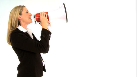 Beautiful businesswoman shouting through a megaphone Stock Video Footage