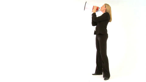 Beautiful businesswoman speaking into a megaphone Stock Video Footage