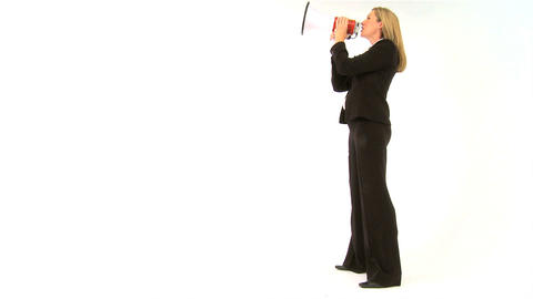Beautiful businesswoman speaking into a megaphone Footage