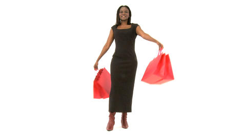 African american woman with shopping bags isolated on white Footage