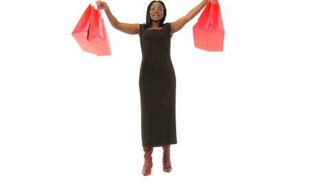 African american woman with shopping bags isolated on white Stock Video Footage
