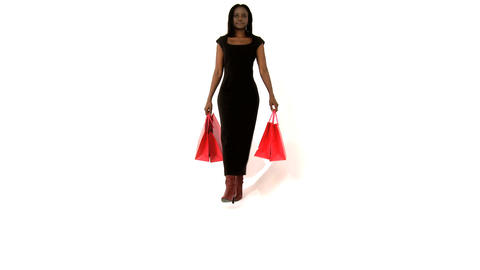 Beautiful african american woman with ping shopping bags Footage