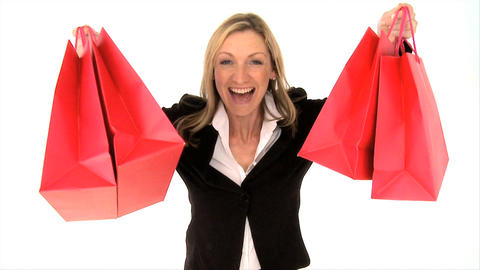 Excited blonde woman with shopping bags isolated on white Stock Video Footage