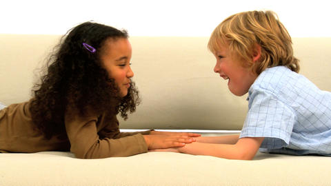 Cute little girl and boy enjoying together Stock Video Footage