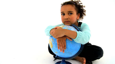 An adorable african american girl embracing a globe Footage
