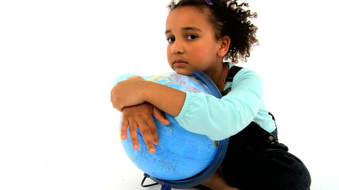 An adorable african american girl embracing a globe Stock Video Footage