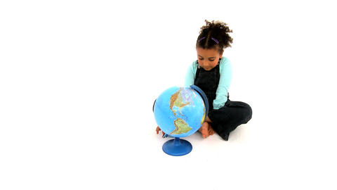 Cute african american girl embracing a globe on white background Footage