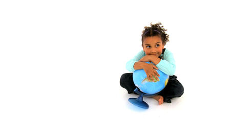 Cute african american girl embracing a globe on white... Stock Video Footage