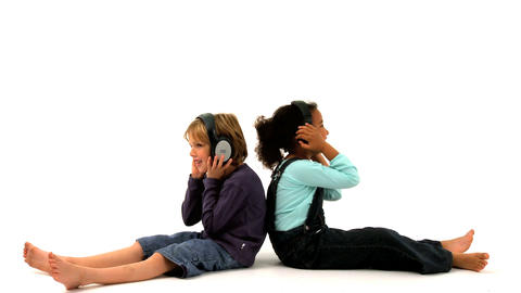 African american girl and blonde boy listening to music on white background Footage