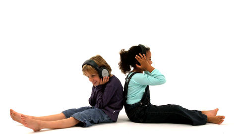 African american girl and blonde boy listening to music... Stock Video Footage