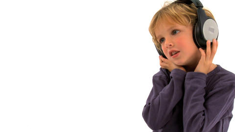 Little boy listening to music and singing Stock Video Footage