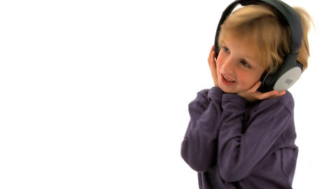 Little boy listening to music and singing Footage