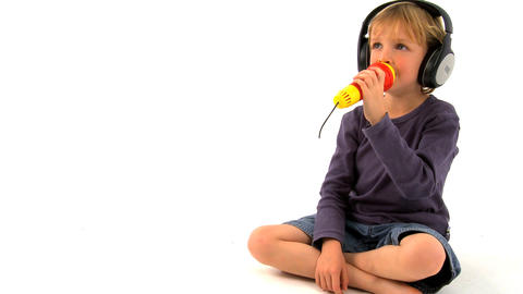 Little boy singing on white background Stock Video Footage