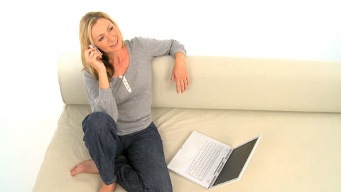 Attractive woman using phone and laptop, motion jib Footage