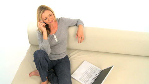 Attractive woman using phone and laptop, motion jib Stock Video Footage
