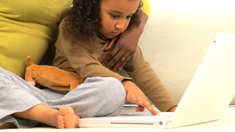 African american mother and her little daughter using a laptop, motion jib Footage
