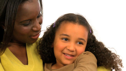 Attractive african american woman embracing her daughter Footage